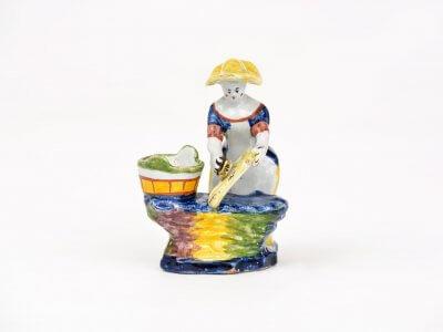 • D1459  Polychrome Figure Of A Woman Scrubbing A Toilet Seat