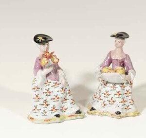 D667. Pair Of 'Petit Feu' Polychrome Figures Of Seated Ladies