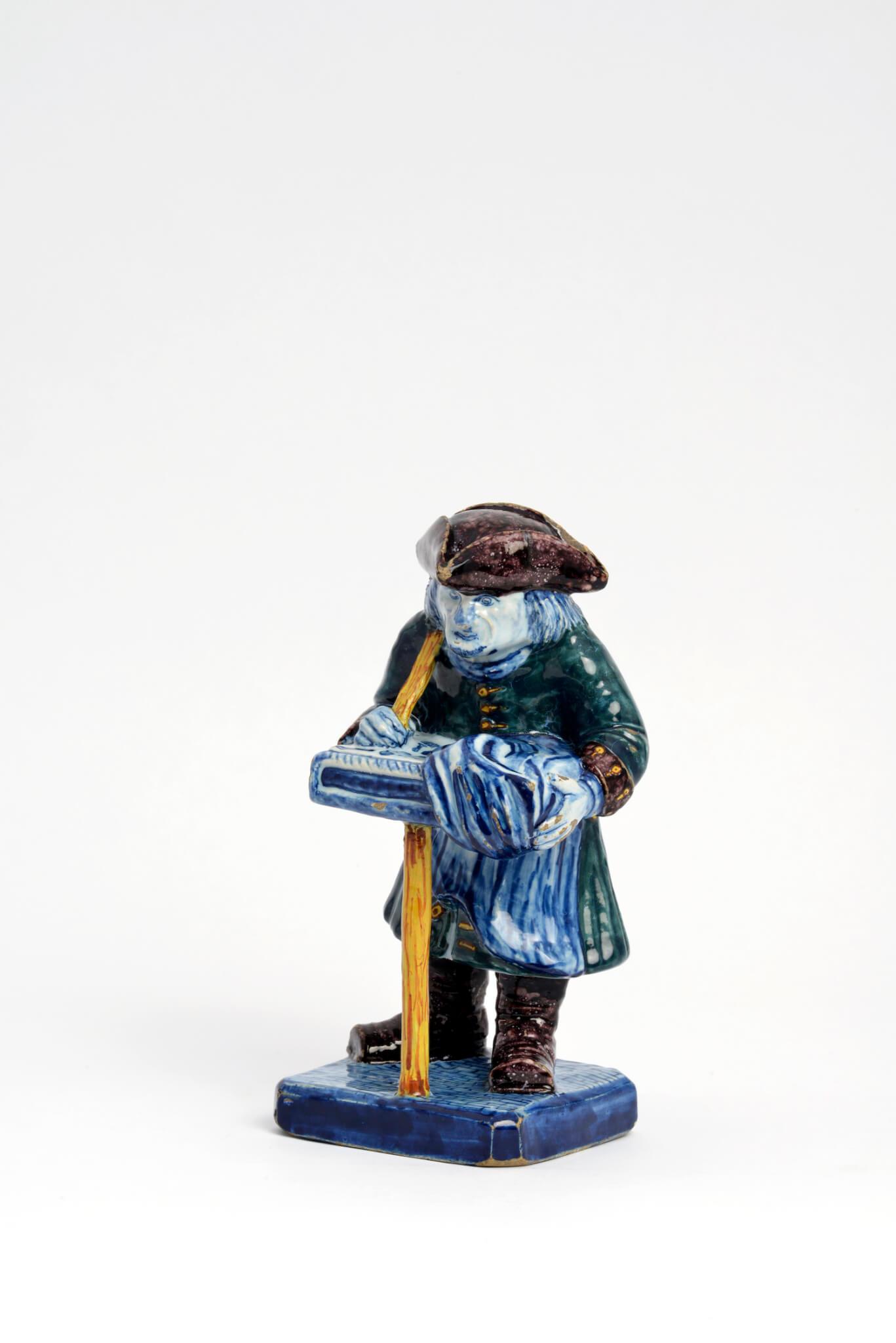 • D1879. Polychrome Figure of a Street Vendor
