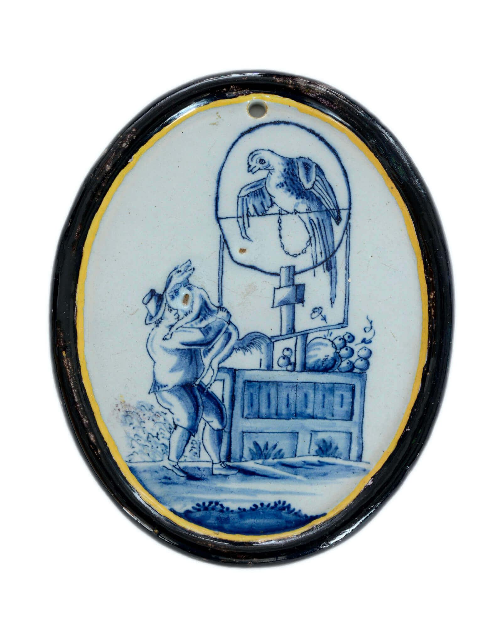 Delftware plaque with bird