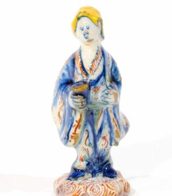 D1010. Polychrome Small Figure Of An Asian Man